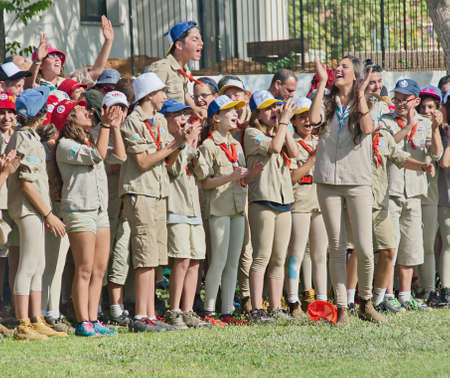 jewish group: TEL AVIV - MAY 9, 2015: Happy Israel Scouts in formation celebrating in a yearly graduation passage ceremony in a Tel Aviv suburb Editorial