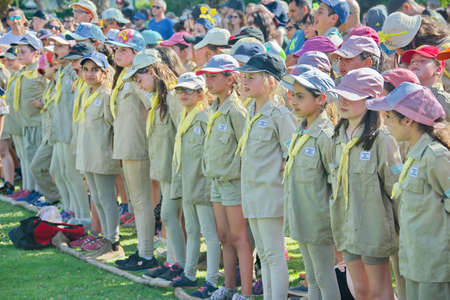 scouts: TEL AVIV - MAY 9, 2015: Happy Israel Scouts in formation celebrating in a yearly graduation passage ceremony in a Tel Aviv suburb Editorial