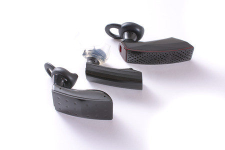 hands free device: A set of three modern wireless bluetooth headsets - headphones - isolated on white