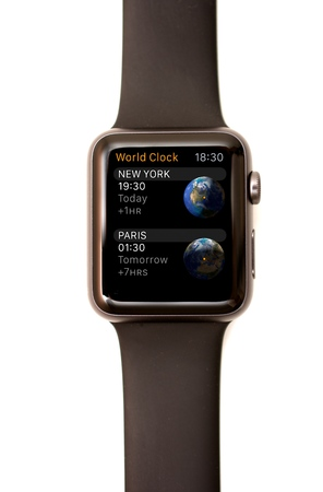 graphically: NEW YORK - JULY 9, 2015: High resolution image of the Apple Watch screen: The World Time app graphically showing the time in New York and Paris