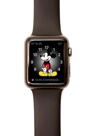 complications: NEW YORK - JULY 9, 2015: High resolution image of the Apple Watch screen: The MickyFace with time, world time, temperature, and calendar complications. Editorial