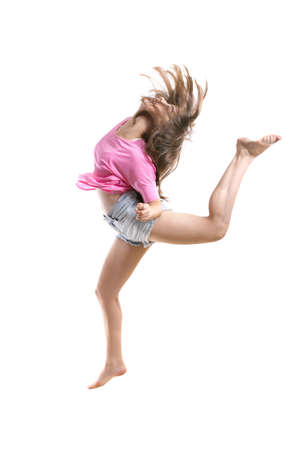 jazz: Agile teenage jazz girl dancer jumping high in the air with her hair in motion