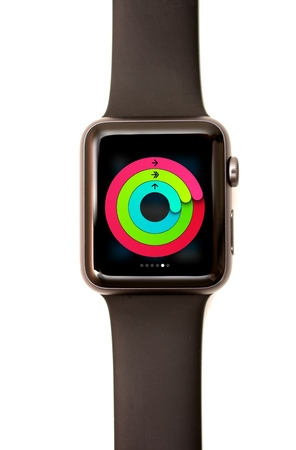 NEW YORK - JULY 9, 2015: High resolution image of the Apple Watch screen: The activity Glance showing the three circles of measuring activity Editorial