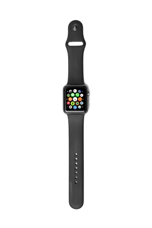 NEW YORK - JULY 12, 2015: Apple Watch Sport with black band  showing the round Watch icons for various apps including stop watch, timer, calendar, email, phone, and more.