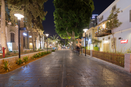 conserved: TEL AVIV - SEPT. 25, 2015: Tel Aviv Night Life - Restored houses at night at the hip Sarona district featuring rich night life and conserved Templer era German architecture from the late 1800s
