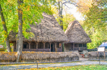 Old traditional straw hut in the Village Museum (Muzeul Satului) in Bucharest, Romania Editorial