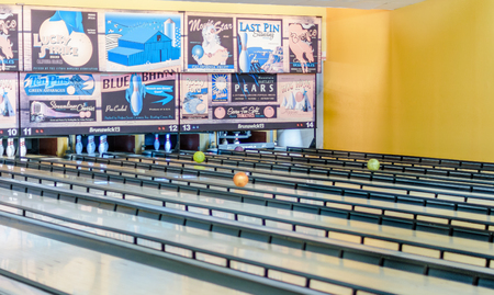 adds: KFAR SABA, ISRAEL - DEC. 12, 2015: A retro style bowling alley near Tel Aviv, Israel featuring old-time bowling adds.