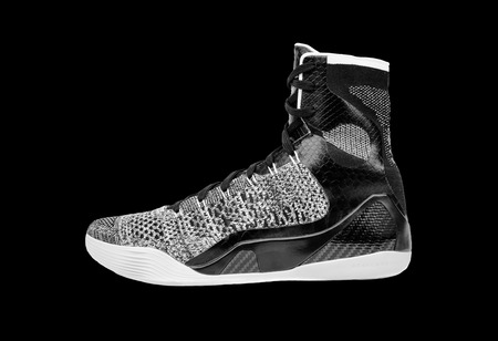 ultra modern: Ultra modern high-top grey and black basketball shoe sneaker, isolated on black