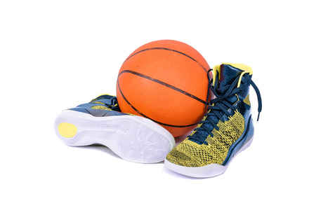 ultra modern: Ultra modern high-top yellow and blue basketball shoes sneakers with a basketball, isolated on white