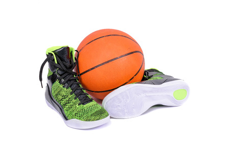 ultra modern: Ultra modern high-top green and black basketball shoes sneakers with a basketball, isolated on white