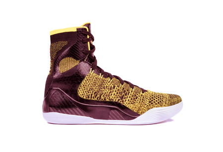 ultra modern: Ultra modern high-top yellow and red basketball shoe sneaker, isolated on white Stock Photo