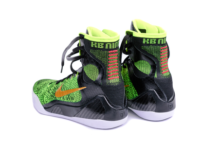 ultra modern: NEW YORK - DEC. 15, 2015: A pair of ultra modern Nike Kobe IX Elite Victory high-top green and black flyknit basketball shoes sneakers, isolated on white