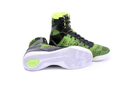 ix: NEW YORK - DEC. 15, 2015: A pair of ultra modern Nike Kobe IX Elite Victory high-top green and black flyknit basketball shoes sneakers, isolated on white