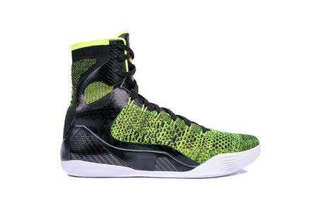 ultra modern: Ultra modern high-top green and black basketball shoe sneaker, isolated on white