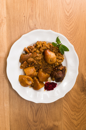 horseradish sauce: Traditional Jewish Cholent (Hamin) prepared is Israel as the main dish for the Shabbat meal made with beef, potato, beans, barley, and more and served with horseradish sauce (Chrein)