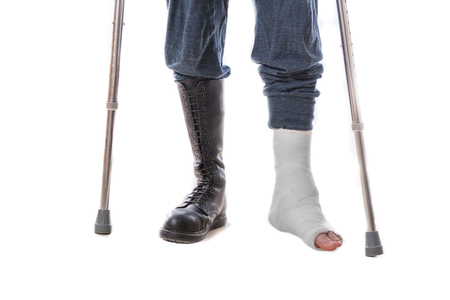 long toes: Leg cast and combat boot (war and injury) - one foot in a cast and one in a combat boot - concept image (isolated on white)