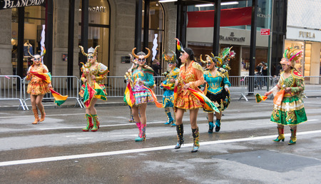 fifth avenue: NEW YORK CITY - OCT. 9, 2016: People marching in the 2016 Hispanic Day Parade, part of the Hispanic National Heritage Month, on Fifth Avenue in Manhattan. New York City