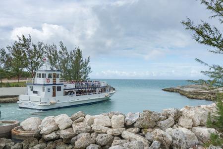caribbeans: COCO CAY, BAHAMAS - OCT 16, 2016: Royal Caribbeans Ship 2 Shore Boat shuttling tourists to Coco Cay Bahamas private tropical island