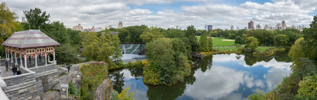 expansive: Wide expansive panorama of Central Parks Turtle (Belvedere) Lake and Swedish Cottage with New York buildings in the background from Belvedere Castle