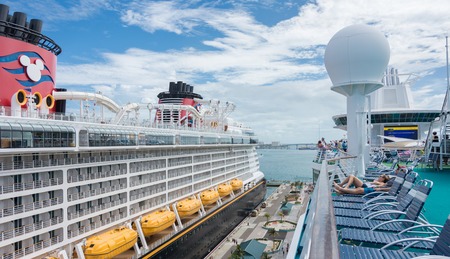caribbeans: NASSAU, BAHAMAS - OCT 15, 2016: Royal Caribbeans Majesty of the Seas and Disneys Disney Dream ships docked in the Nassau Port on New Providence Island