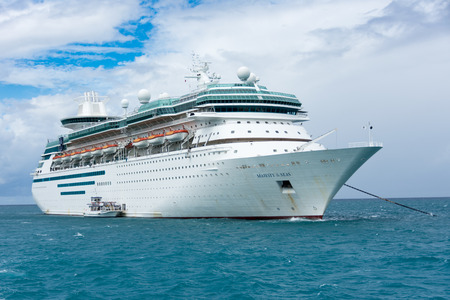 caribbeans: COCO CAY, BAHAMAS - OCT 16, 2016: Royal Caribbeans Majesty of the Seas from the Coco Cutter II boat shutlling tourists to the Coco Cay private island