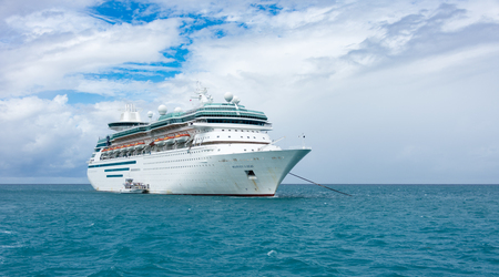 COCO CAY, BAHAMAS - OCT 16, 2016: Royal Caribbeans Majesty of the Seas from the Coco Cutter II boat shutlling tourists to the Coco Cay private island