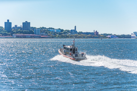 coast guard: NEW YORK - OCT 10, 2016: US Coast Guard boat protecting the Manhattan - Staten Island Ferry and the New York Upper Bay