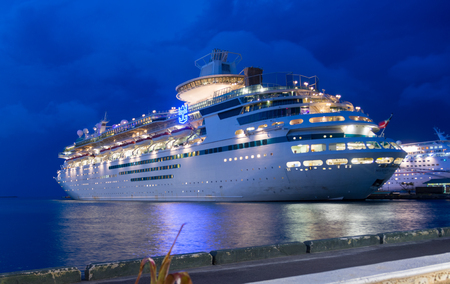 caribbeans: NASSAU, BAHAMAS - OCT 15, 2016: Royal Caribbeans Majesty of the Seas from the Coco Cutter II boat shutelling people to the Coco Cay private island