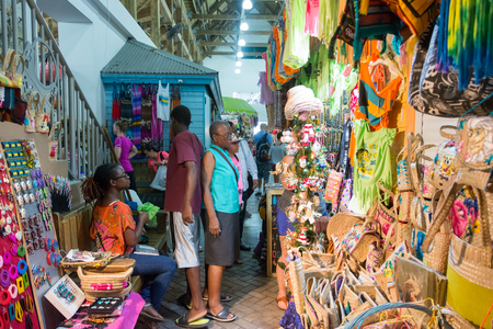 famous industries: NASSAU, BAHAMAS - OCT 15, 2016: The famous Nassau Straw Market, where local merchants sell hand-crafted straw and other merchandise. Straw vending is considered one of the countrys oldest industries.