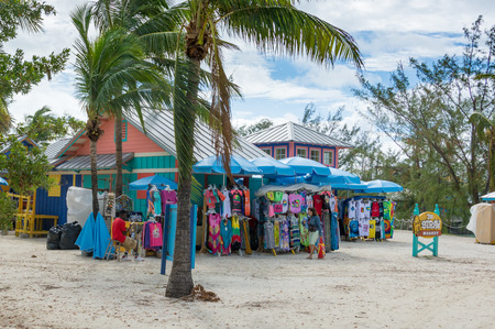 cay: COCO CAY, BAHAMAS - OCT 16, 2016: The Straw Hat colorful cabin selling beach clothes on a tropical Caribbean beach in Coco Cay, Bahamas