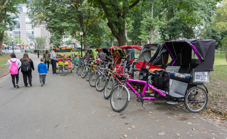 standby: NEW YORK CITY - OCT. 8, 2016: Central Park Pedicabs (Rickshaw) on standby for a romantic tour of the park Editorial