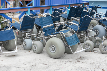 cay: COCO CAY, BAHAMAS - OCT 16, 2016: Specialized beach sand wheelchairs used on the beach and other sandy surfaces Editorial