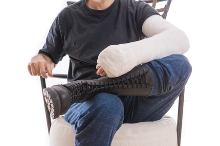 Long arm cast and combat boots (war and injury) - concept image (isolated on white)