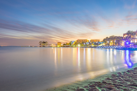 Sunset and blue hour in the Eilat harbor on the Red Seas Gulf of Aqaba.  Eilat is Israels main vacation resort bordering between the Red Sea and Negev Desert.