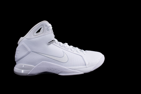 NEW YORK - APR 1, 2017: Modern performance Nike Hyperdunk high-top mid-top white  basketball shoe sneakers, isolated on black