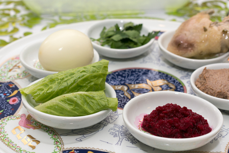 Traditional Passover Seder plate with six items which have significance to the retelling of the story of Passover - the exodus from Egypt, which is the focus of this ritual meal. Stock Photo