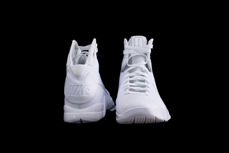 illustrative editorial: NEW YORK - APR 1, 2017: Modern performance Nike Hyperdunk high-top mid-top white  basketball shoe sneakers, isolated on black