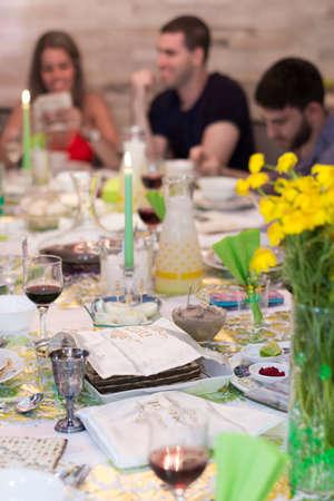 israeli: TEL AVIV - APRIL 10, 2017: Modern secular Israeli family sitting together for a traditional Passover Seder dinner