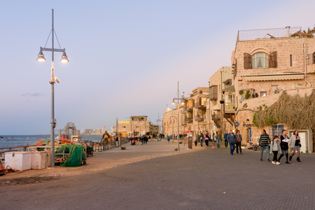 jaffo: TEL AVIV - MARCH 4, 2017: People touring the beautiful old international city of Jaffa near the Mediterranean port on a warm spring evening