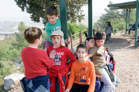 JERUSALEM - FEB. 11, 2017: Group of Isaraeli fourth grade school kids and their parents on a field trip in a forest near Jerulaem