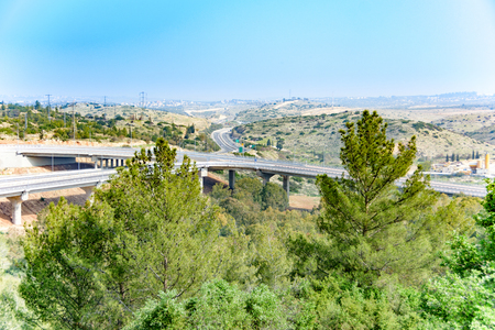 The Shomron mountains and Cross-Israel Road (road 5) from where the road enters the West Bank.  Taken from the hills of Rosh Haayin, one of the fastest growing cities in Israel.