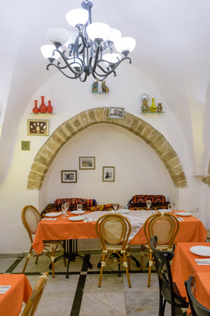jaffo: TEL AVIV - MARCH 4, 2017: A seafood restaurant in a renovated landmark old house in the old city of Jaffa, Tel Aviv, Israel Editorial