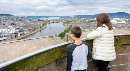 Two kids admiring the views of Inverness, Scotland, United Kingdom from the Inverness Castle tower.