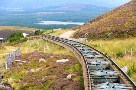 Funicular train tracks in Cairngorm national park leading tourists in the summers and skiers int he winter to the Cairn Gorm mountain summit