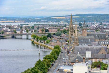 View of Inverness, Scotland, United Kingdom from above featuring Old High Church and the River Ness.  Taken from the Inverness Castle tower.