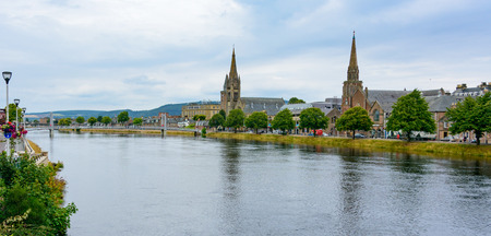 View of Inverness, Scotland, United Kingdom featuring Old High Church, the River Ness, and Greig St. Bridge Stock Photo