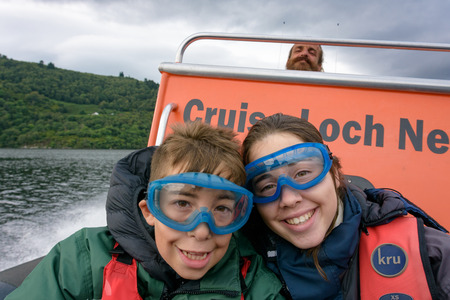 LOCH NESS - AUG. 22, 2017: Tourists speedboating on a RIB boat (perhaps hoping to find Nessie the Loch Ness Monster) on the iconic Loch Ness, Scotland Editöryel
