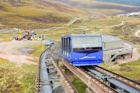 CAIRNGORMS, SCOTLAND - Aug 21, 2017: Funicular train in Cairngorm national park leading tourists in the summers and skiers int he winter to the Cairn Gorm mountain summit Editorial