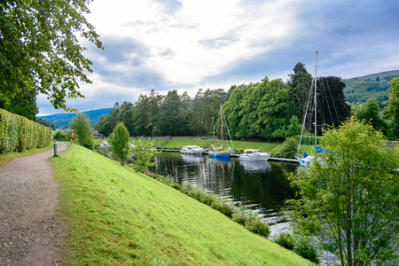 FORT AUGUSTUS, SCOTLAND - AUG 22, 2017: The Caledonian Canal and boats at Fort Augustus and Loch Ness.  The canal connects the Scottish east coast at Inverness with the west coast near Fort William.