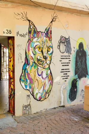 TEL AVIV - OCT 13, 2017: Modern grafitti art in the hip streets of south Tel Aviv on the pedestrian street of Nahlat Binyamin Editorial